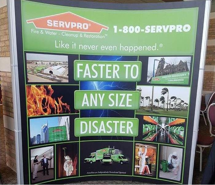 A SERVPRO sign with Faster To Any Disaster on it and images from jobs.